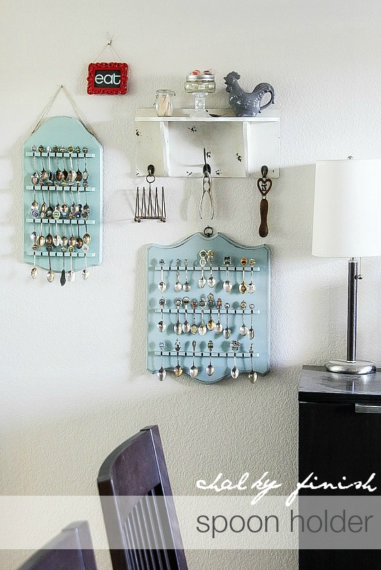 wooden spoon racks hanging on a dining room wall