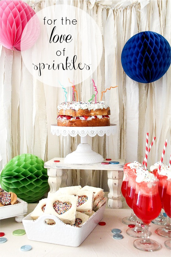 a party food table where everything has rainbow sprinkles on it