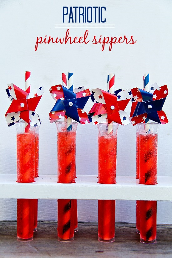 red drinks in test tubes with red blue and white pinwheel straws
