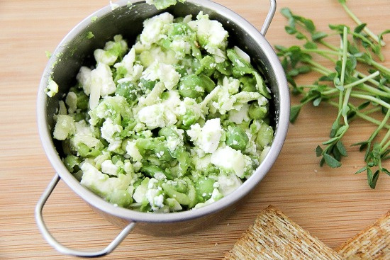 feta cheese mixed with peas and microgreens