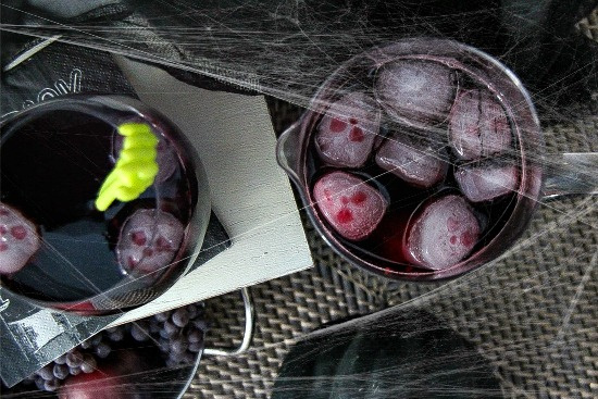 red wine with skull ice cubes for halloween