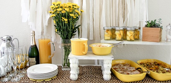 a yellow and white summer brunch table