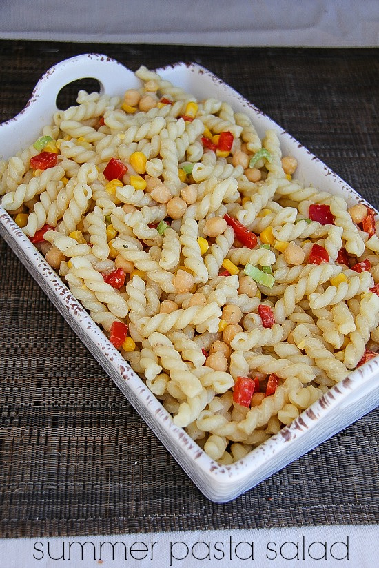 a pasta salad with garbanzo beans, corn, and bell peppers