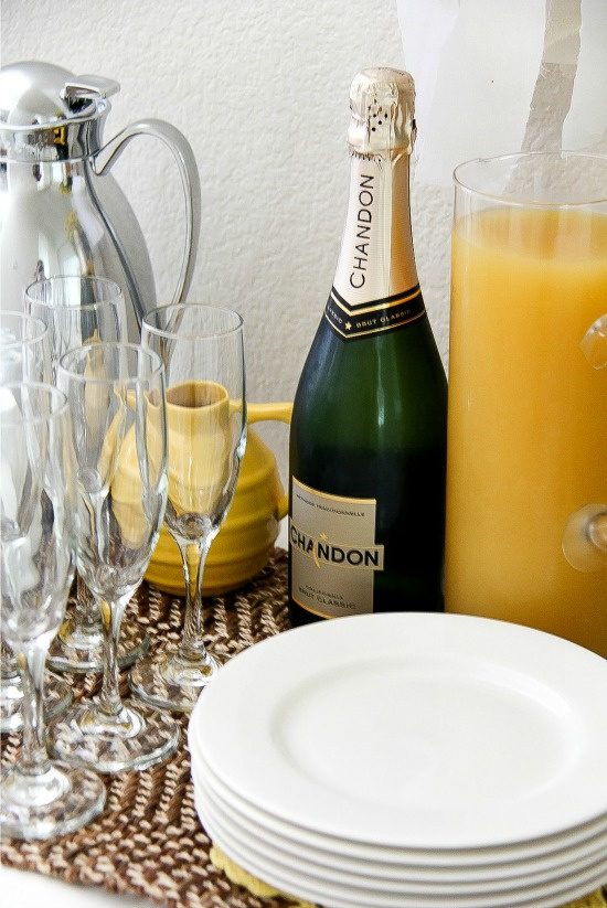 a bottle of Chandon sparkling wine with a pitcher of orange juice to make mimosas