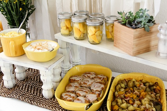 brunch items in yellow casserole and baking dishes