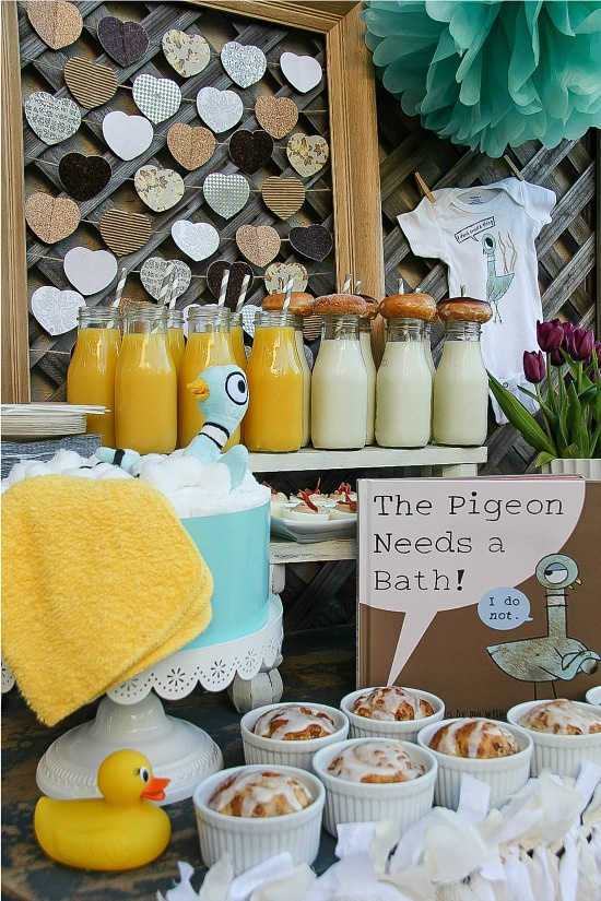 a book themed baby shower table inspired by Mo Willems the pigeon needs a bath