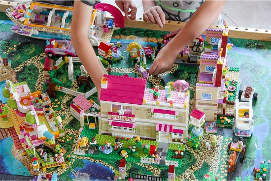 children playing with a LEGO Friends town