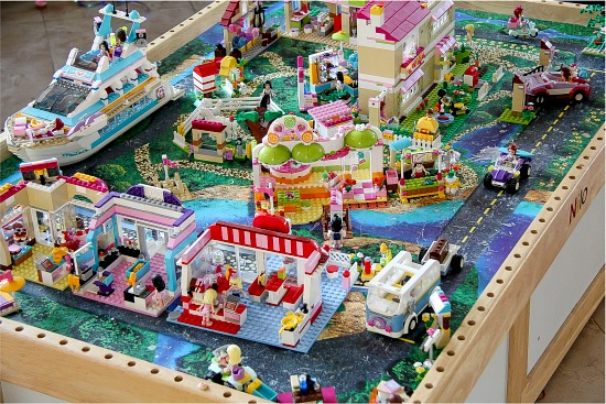 a LEGO Friends town built on an old train table