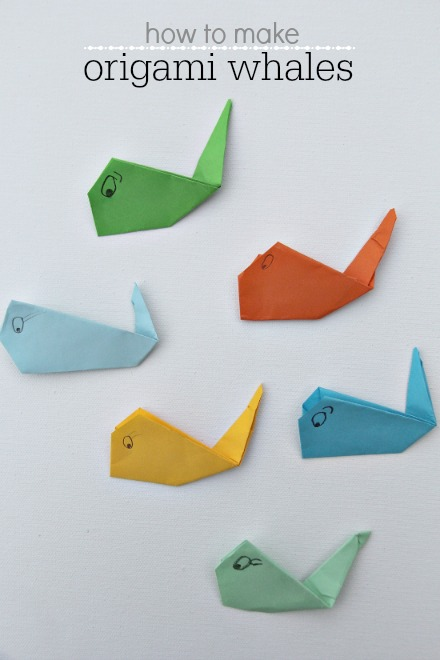 origami whales in different colors made by kids