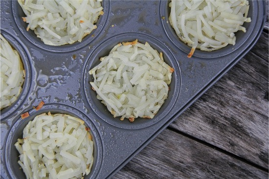 hash browns pressed into muffin tins