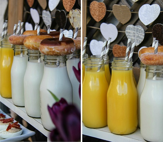 small bottles filled with milk and orange juice and topped with donuts