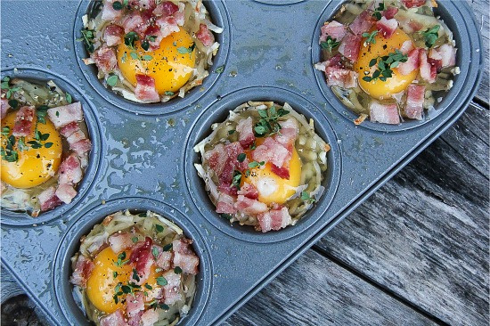 hash browns, egg, bacon, and herbs in muffin tins