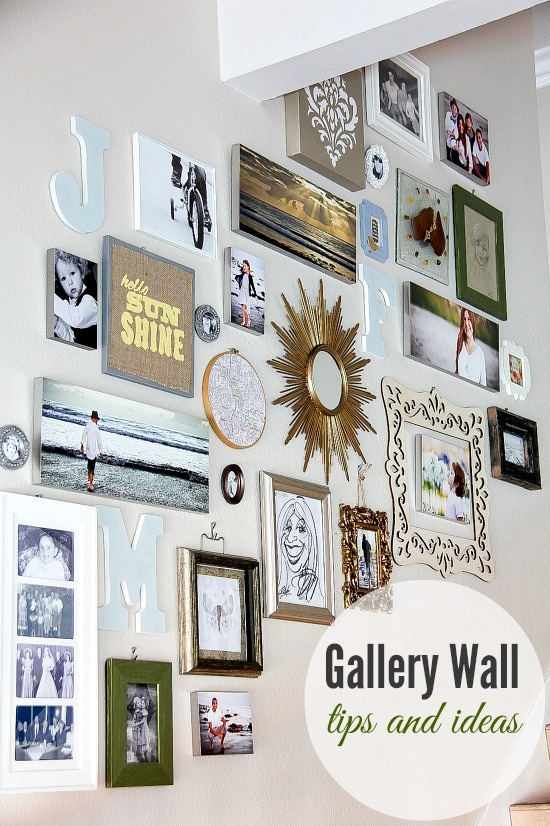 A gallery wall on a staircase of photos, art, and mirrors