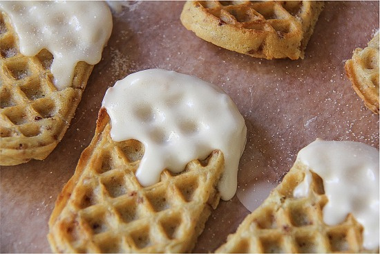 waffle sticks dipped in icing and cinnamon sugar