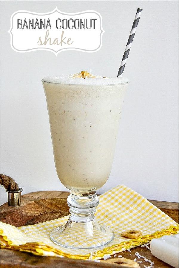 a banana coconut shake in a milkshake glass with a grey straw