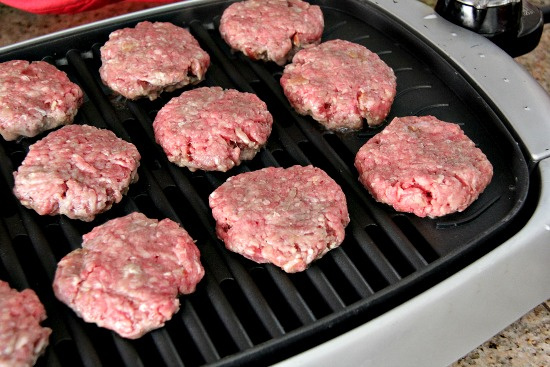 burgers cooking on an indoor grill