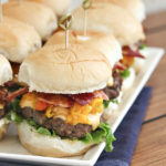 cheeseburger sliders with corn relish and bacon on slider buns