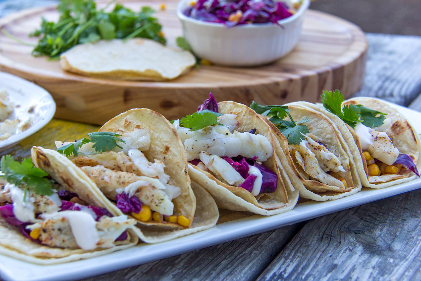 grilled fish corn tacos with red cabbage and corn
