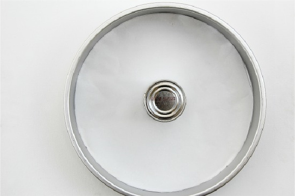 a cake pan with a tin can in the middle to make an angel food cake