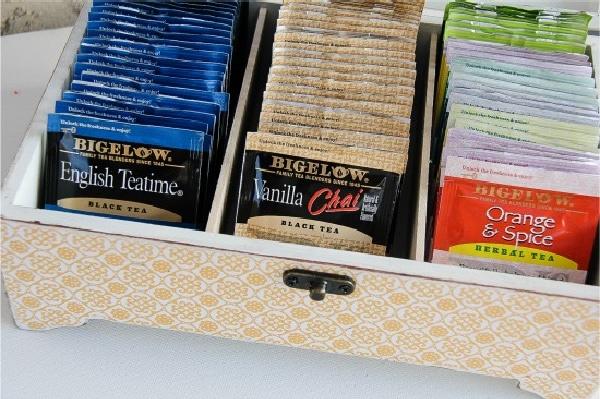 a handmade tea storage box filled with tea