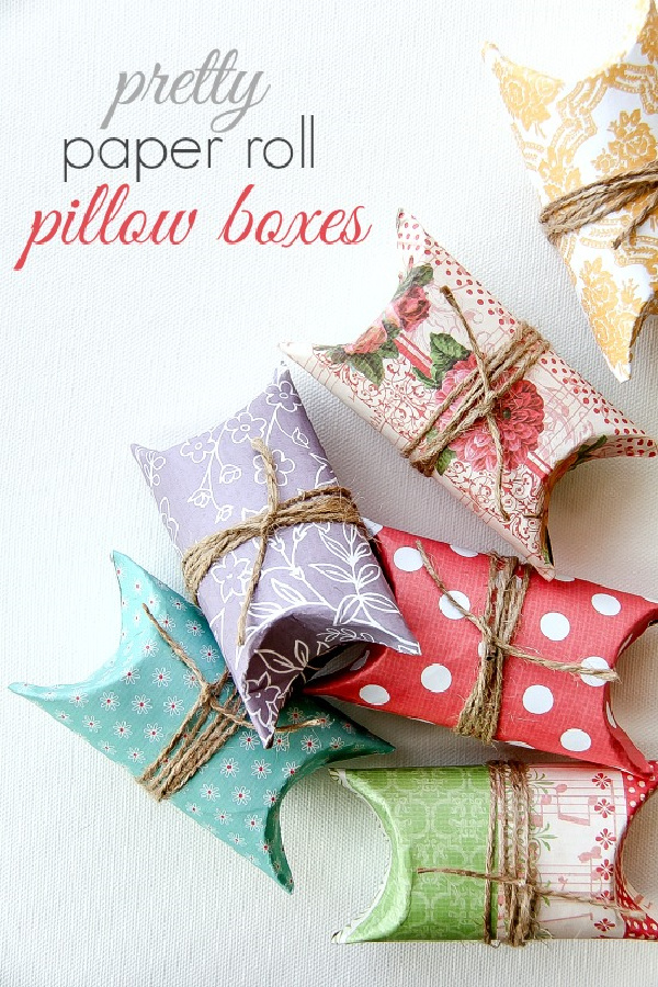 paper rolls wrapped in scrapbook paper and twine to make gift packages