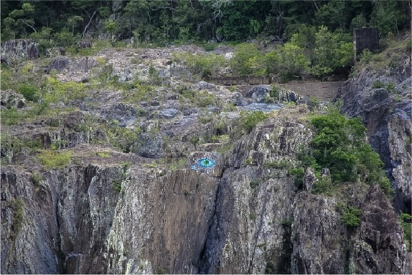 a blue eye painted on the side of a mountain in queensland