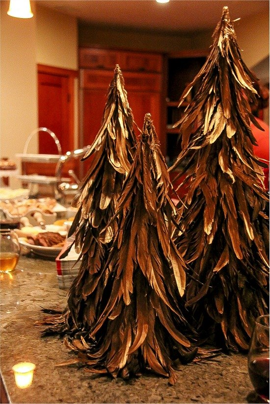 feather christmas trees and party food on a counter