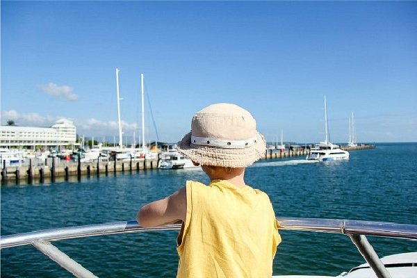 boy on the deck of the reef king catamaran at the great barrier reef