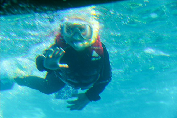 boy snorkeling great barrier reef