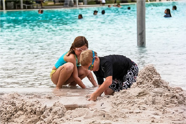 kids playing in the sand at the Cairns Esplanade Lagoon
