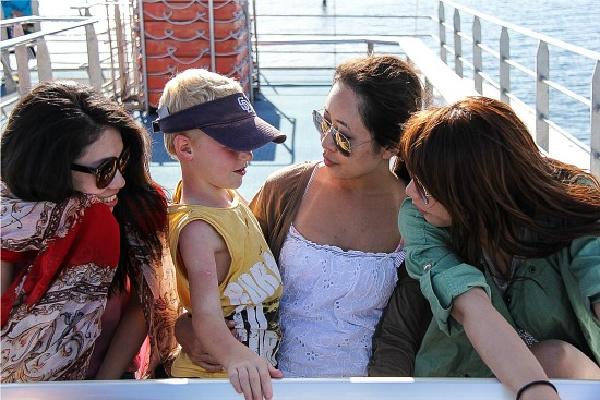 boy and female tourists on a catamaran