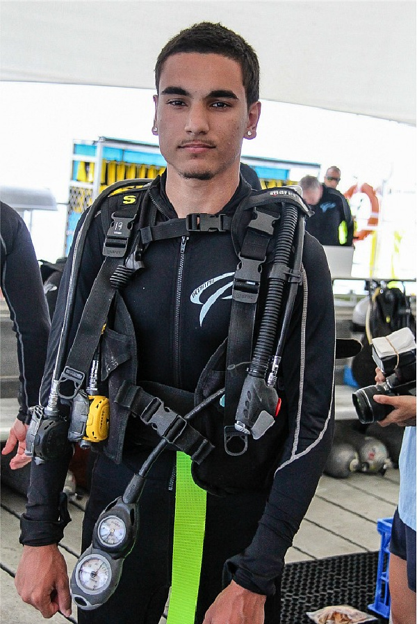 young adult male dressed in scuba diving gear