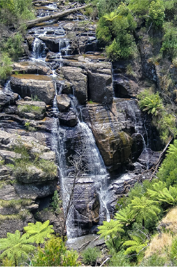 water cascading over rocks at masons falls in kinglake national park victoria australia