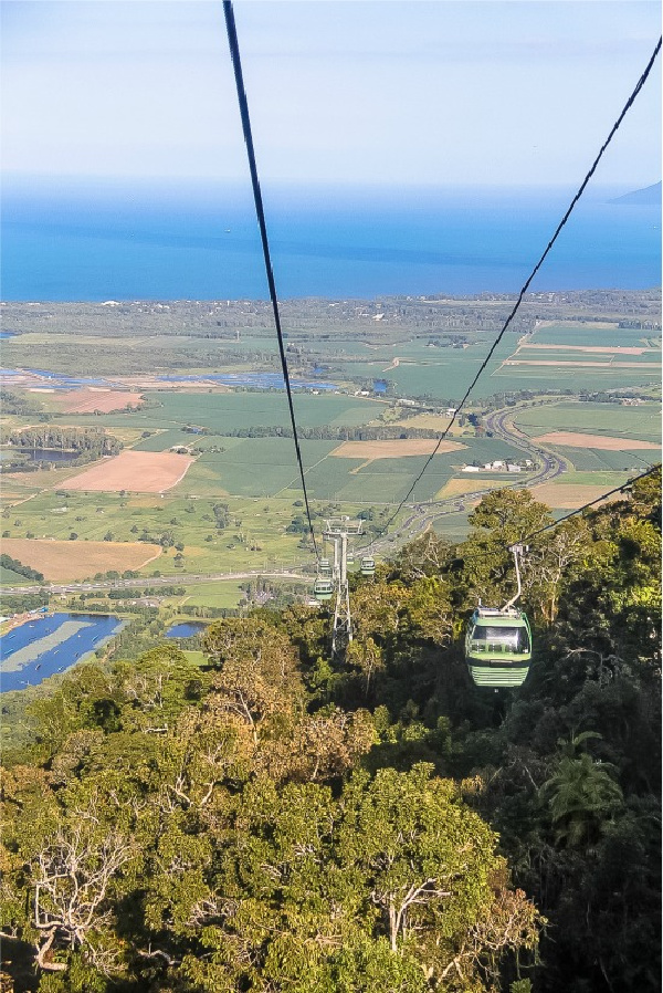 view over the ocean from the kuranda skyrail as it comes down the mountain