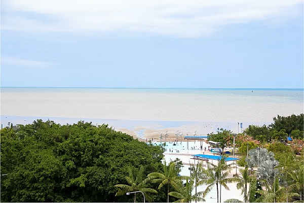 view over the ocean in cairns at low tide from The Mantra