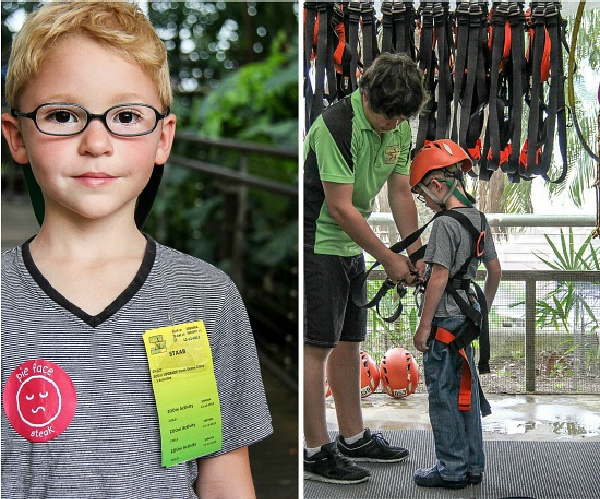 a boy getting a harness to do the ZOOm obstacle course in Cairns