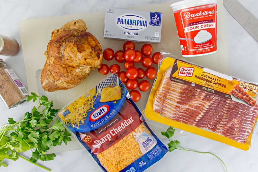 Ingredients laid out on a counter for making a Kentucky Hot Brown dip.