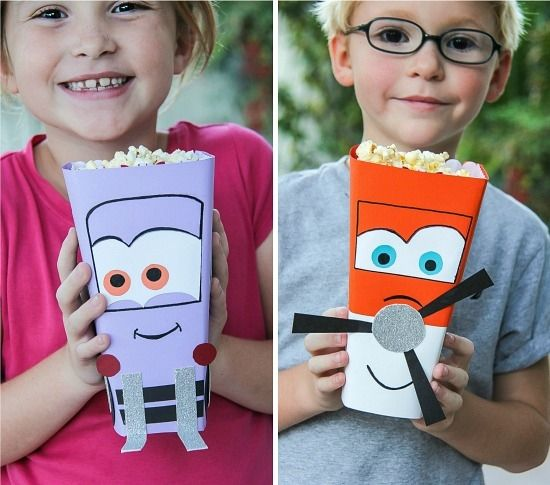 Kids holding handmade Disney Planes Dusty Crophopper and Dottie popcorn tubs for a movie night