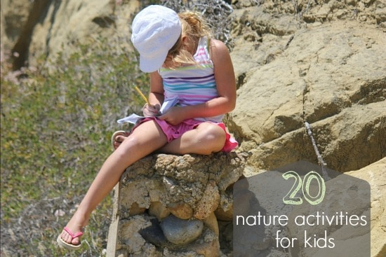 girl sitting on a rock in nature doing an educational activity