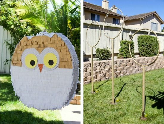 Harry Potter owl pinata and quidditch hoops in a backyard for a party.