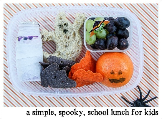Halloween bento style lunch box for kids including a ghost sandwich.