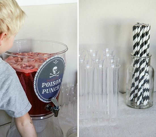 Poison punch served in a beverage dispenser, with test tubes and straws for a Harry Potter Halloween party