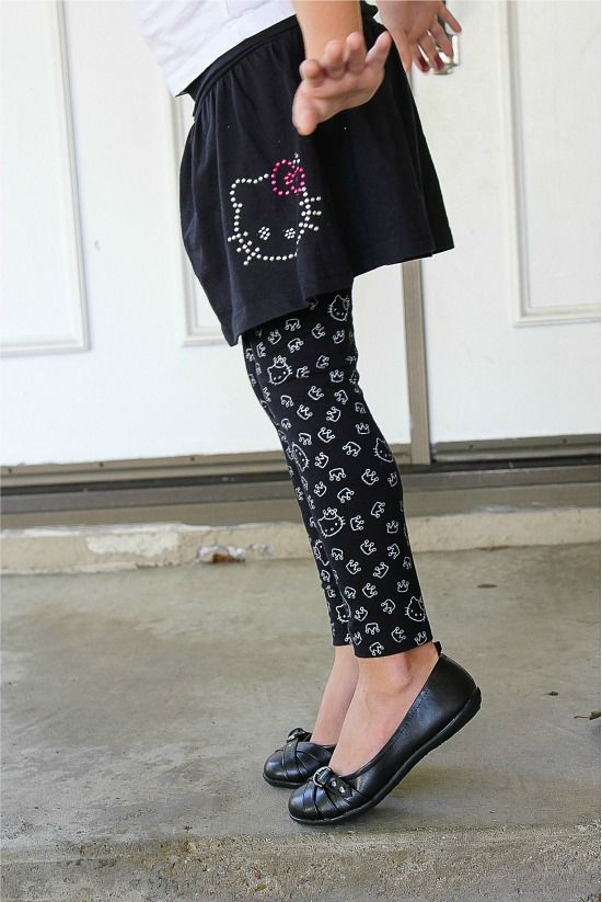 girl wearing a black Hello Kitty skirt with black and white Hello Kitty leggings