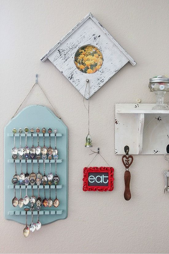 dining room wall decor including a wooden spoon holder