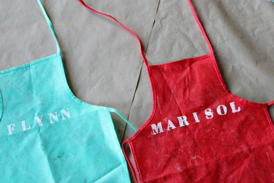 personalized aprons in red and green for kids to decorate holiday cookies