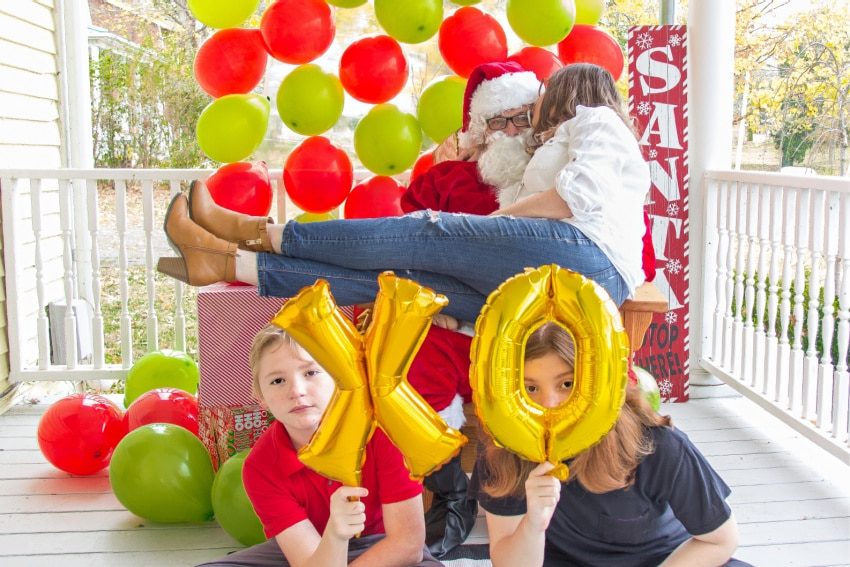 family taking their own Christmas photo with balloons