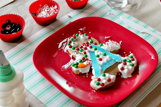 gingerbread man decorated with icing and candy for the holidays