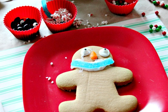 a gingerbread man cookie decorated with candy