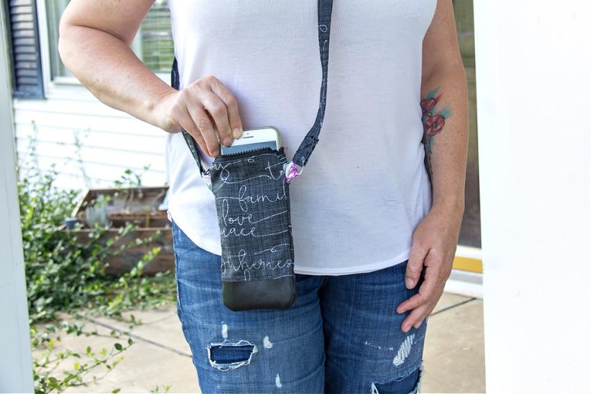 girl holding a handmade cross-body phone purse