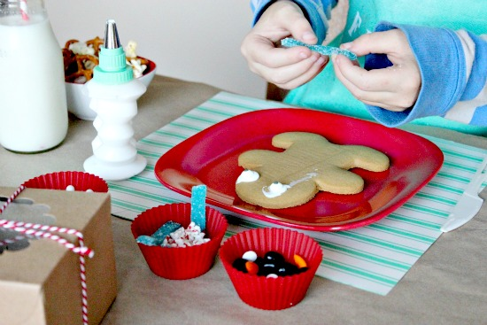 a child decorating holiday cookies